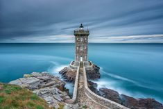 Lens filters can drastically affect landscape photography. Lighthouse against azure blue ocean.