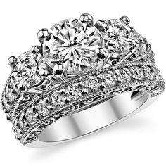 Antique Round Moissanite 3-Stone Wedding Ring- like the thick band, but maybe just the main band