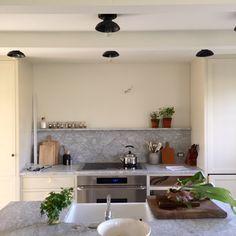 I love this marble slab backsplash with ledge behind stove. Lauren Leiss blog