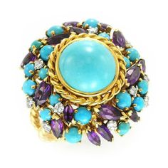 A TURQUOISE AND AMETHYST RING, BY MEISTER