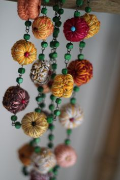 .i think these are crochet flowers.  i love the mix of soft flowers and the glass beads