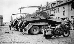 Pre-war photograph of two Sd Kfz 232 (front and rear), and a Schwerer Panzerspähwagen (Sd Kfz 231) (6 Rad). Description from panzerphotos.com. I searched for this on bing.com/images