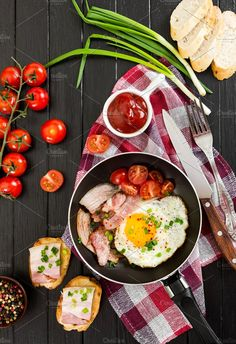 Fried eggs with ham and tomatoes by Nataliia Pyzhova on @creativemarket
