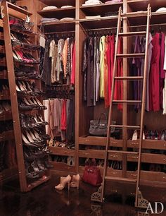 Shields's closet, built of rift-sawn white oak, is outfitted with a rolling shoe rack and library ladder by Putnam Rolling Ladder Co.