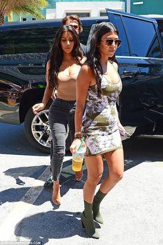 Kourtney Kardashian wearing Roberto Cavalli Stretch-Jacquard Mini Dress and Yeezy Season 2 Knit Ankle Boot
