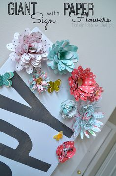 Make a Giant Sign and paper flower tutorial at tatertots and jello. An easy way to brighten up your home for Spring!