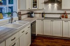Nip Tuck Remodeling utilized Formica 180fx Travertine Silver as a stylish cost-saving countertop option in this Seattle, WA traditional kitchen remodel.