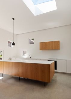 Roof lights accentuate the natural light that permeates the interior of this house extension in Sydney.