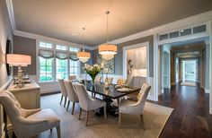 This Neutral Dining Room Is Full Of Interest And Beauty. Notice The  Transoms In The Large Hallway, The Butler?s Pantry And The Double  Chandeliers Above The ...
