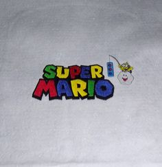 20 square table toppers for a February 27th bar mitzvah with a Nintendo game theme. After the bar mitzvah, the toppers will be assembled with fun backings and turned into zippered pillowcases for decorative throw pillows.