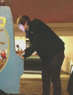 Dan Howell, why is he so cute while playing the arcade game?! how is it that this is the first time ive seen this photo
