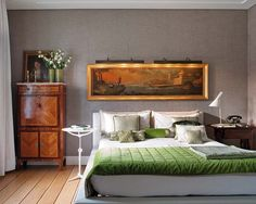 the art, the linens, the wall color and the light - so much to love here