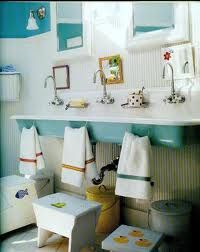 cute children's bathroom, I love the huge sink & multiple faucets even the hand towel under the sink so they can actually reach