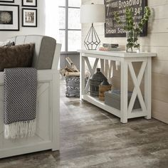 This Home Styles Seaside Lodge Hand Rubbed White Console Table provides a warm inviting cottage feel to your home decor. Seaside Lodge, Seaside Cottage Decor, Seaside Cottages, Home Living Room, Living Room Decor, White Console Table, Console Tables, Entryway Console, White Sofa Table