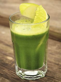 Vitamix Daily Green Smoothie recipe.. made up of pineapple, green grapes, pear, avocado, broccoli florets, and spinach..