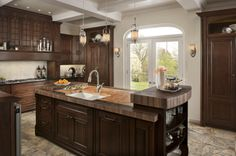 Stunning kitchen with WoodMode cabinetry and Franke by Villeroy & Boch sink, MHK720-31WH and pull down faucet, FHPD580.