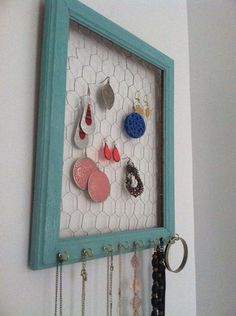 Jewelry holder with necklace holders. I wonder if I can make this a key holder
