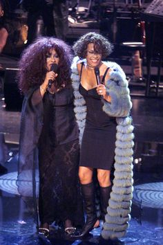 Whitney performs with Chaka Khan in 1999