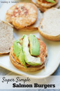 These salmon burgers are one of the easiest recipes ever!  Just a few simple ingredients make a healthy family lunch or dinner that's done in under 15 minutes. (Sponsored by Seafood Nutrition Partnership) #SNPSweepstakes #HealthyHeartPledge #ad