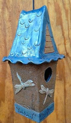 Unique pottery birdhouse features rich color, texture and dragonflies set against natural terracotta. Perfect on the porch or in the garden, each is handcrafted and meant for birds! Features lift-off