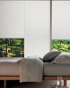 Relax in the smart style and energy saving warmth of Duette® honeycomb shades.  ♦ Hunter Douglas window treatments #Bedroom
