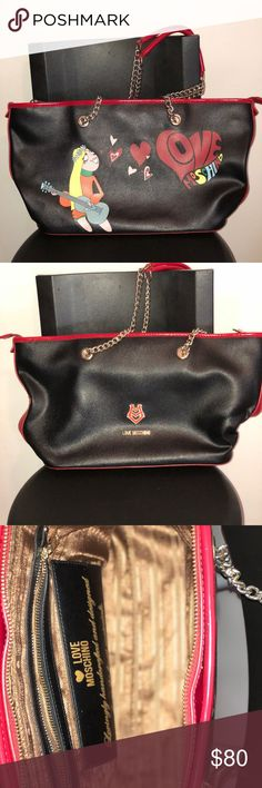 Moschino bag Black with a splash of red Moschino bag. It's used a little wear and tear but nothing noticeable! Any questions just comment below ⬇️ Love Moschino Bags Mini Bags