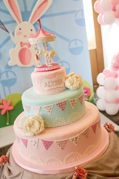 Carousel Cake, love the colors and bunting!