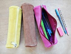 Handmade Suede Leather Pencil Case  This suede leather case comes in Yellow, Tan and Pink-Fuchsia color. Has one main compartment, zipper closure and is suitable for storing pencils, pens, your makeup accessories or stationery. You can also use it as a travel case.  A perfect gift for yourself or your friends.   DIMENSIONS:  Length: 8.26  / 21 cm Diameter: 2.75  / 7 cm   100% Suede Leather    Our Items are handmade and may have slight variations between the same items. Leather proce...