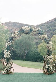A classic arch of intertwining branches, hydrangeas, and roses.