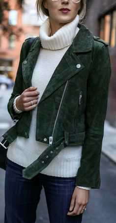 hunter green suede moto jacket, medium wash flare leg jeans, ivory chunky knit cowl neck sweater