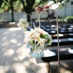 Luv luv luv.  Neutral flowers down the aisle in a hanging glass vase.