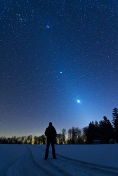 Venus and Jupiter are this month's two brightest planets. Shortly after sunset on February 20, they dominate the sky above the western horizon and this snowy landscape. In clear and transparent skies over Cherry Springs State Park, Pennsylvania, USA, they are also seen immersed in Zodiacal light.