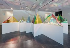 SO-IL have designed these coloured acrylic display cases in geometric shapes to showcase pieces by German porcelain brand Meissen