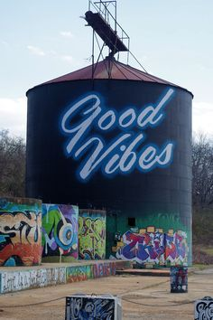 """Good vibes"" grafitti art in the River Arts District, near the French Braod River in Asheville, NC."