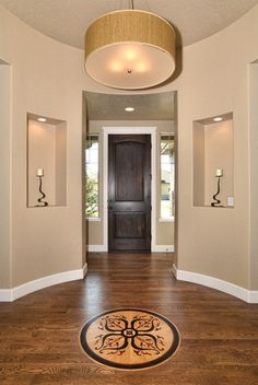 Inset in Entryway Wood Floor ... also like the round entry
