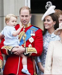 """""""Prince George's blue outfit with cream lace is a family heirloom worn by Prince William for his first appearance on the balcony in 1984."""" — Emily Nash on Twitter"""