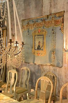 Gustavian Style - Love the wall - love the tall candles in the chandelier.