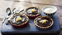 The chocolate tarts make a quick and easy dessert. Make it even easier by using ready-made tart cases.