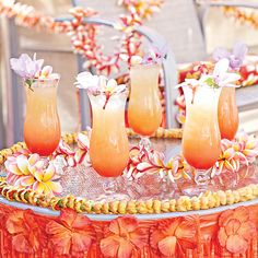 Leis and grass skirts on guests (and furniture) and tropical fruits and flowers in cakes and cocktails. Now that's some Hawaiian punch! Party Plan Menu:gr