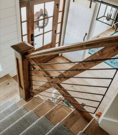 Perfect foyer - farmhouse front door with sidelights, sliding barn door, custom wrought iron staircase railing Home And Deco, House Goals, Basement Remodeling, My Living Room, Stair Railing, Staircase Spindles, Iron Staircase, Staircase Ideas, Wood Stairs