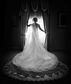 Black and White Photo of Dramatic Cathedral Veil    Photography: Carasco Photography  @carascophoto http://www.carascophoto.com  Gown: Matthew Christopher http://www.matthewchristopher.com  Planning: Kesh Events http://www.keshevents  Makeup: Makeup by Aga http://www.makeupbyaga.com  Read More:  http://www.insideweddings.com/weddings/new-york-yankees-infielder-marries-in-opulent-chicago-soiree/764/