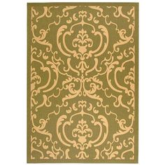 Add classic beauty to any area of your home with this green indoor and outdoor area rug featuring a geometric pattern inspired by Persian and Egyptian art. The rugs polypropylene construction makes it resistant to harsh weather conditions.