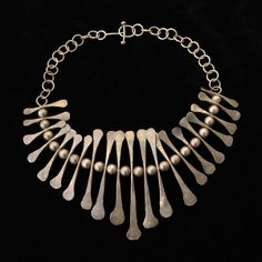 MID-CENTURY MODERN STERLING SILVER NECKLACE, Estimate: $300/400 http://www.michaans.com/highlights/2013/highlights_08042013.php