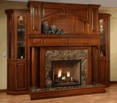 Fireplace Mantel Wall Unit.  Our experienced craftsmen employ only the finest materials to produce beautiful wood mantels that consumers have treasured for years in their homes. We offer a vast array of designs that will complement and enhance any decorating scheme. Wouldn't you really rather have a USA handmade heirloom to finish your fireplace? No Imports!