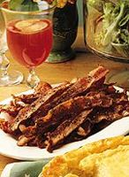 Oven-Baked Pepper Bacon - 1 1/2  pound(s)  sliced lean bacon   2 1/2  teaspoon(s)  coarsely ground black pepper 1.Preheat oven to 400 degrees F. Arrange bacon slices in 2 jelly-roll or roasting pans, overlapping the lean edge of each slice with the fat edge of the next. 2.Evenly sprinkle pepper over bacon slices. Place pans on 2 oven racks and bake bacon 25 minutes, switching pans between upper and lower racks halfway through baking, until bacon is golden brown and crisp.