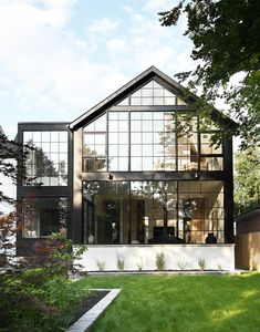 The house features an exterior wall made completely of steel-paneled glass windows. Save for a finished basement and a few walls above ground, this Ontario, Canada residence, designed by Nicholas Ancerl of Ancerl Studio, was built completely anew to fulfill the homeowner's wishes of a country-chic home. #interiordesign #architecture #homedecor Black Window Frames, Black Windows, Windows And Doors, Ontario, Toronto, Black Accent Walls, Style Loft, Metal Stairs, Industrial Windows