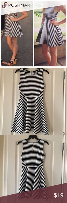 """Sleeveless Striped Dress H&M Divided black & white short striped jersey dress Size US6/EUR 36. Zipper at the back of the neck. Seam at the waist. Flared skirt. It is not lined. Very fun and comfortable to wear yet looks classy with heels or wedges. 51% polyester, 45% viscose, 4% elastane. The bust is about 27"""", the waist is about 24"""", the length from shoulder to hem about 31"""". H&M Divided Dresses"""