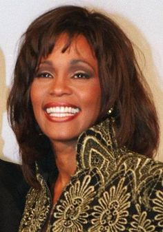 Whitney Houston - Smile that lite up the room.