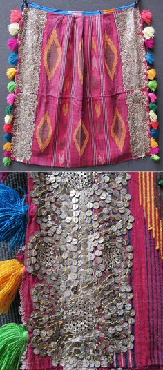 A bridal 'önlük' (women's apron, called 'önücek' locally) from the Sandıklı district (Afyon province).  Mid-20th century.  The fabric was woven on small looms in some artisan workshops of Afyon town.  The decoration with tassels, metal sequins and 'tel kırma' embroidery (motives obtained by sticking narrow metallic strips through the fabric and folding them) is the work of the bride and her female housemates.  (Inv.nr. önL085 - Kavak Costume Collection - Antwerpen/Belgium).