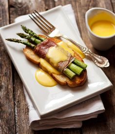Asparagus and Prosciutto Crostini with Fontina Cheese Sauce via Seasons and Suppers